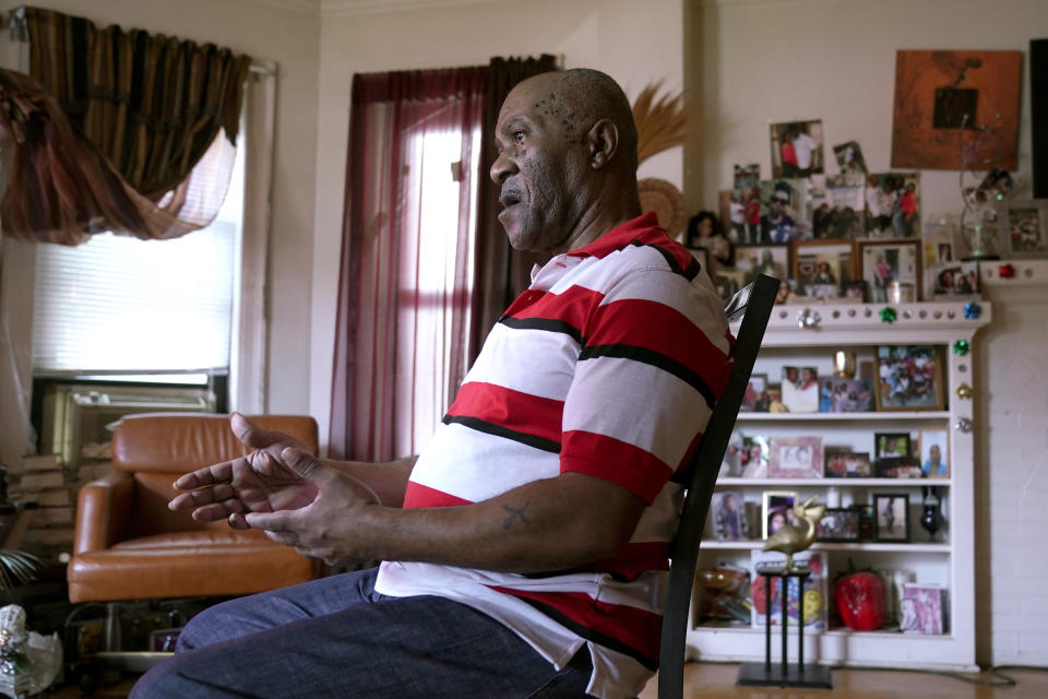 """Michael Williams sits for an interview in his South Side Chicago home Tuesday, July 27, 2021. After prosecutors used ShotSpotter evidence to build their case against Williams, who spent 11 months behind bars before being released, he said, """"I kept trying to figure out, how can they get away with using the technology like that against me?"""" he asked. """"That's not fair."""" Williams was released after nearly a year because of insufficient evidence. (AP Photo/Charles Rex Arbogast)"""