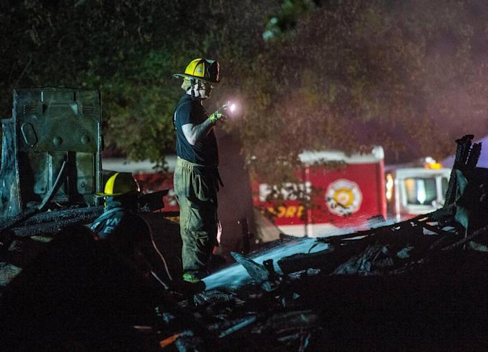 Raytown firefighters and police look over the scene after a duplex exploded in 7500 block of Englewood Avenue, Monday, June 28, 2021 in Raytown, Mo. The cause of the fire is still under investigation