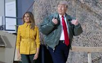 US President Donald Trump, wearing his Commander in Chief jacket, visits members of the US military during his trip to Al-Asad Air Base in Iraq