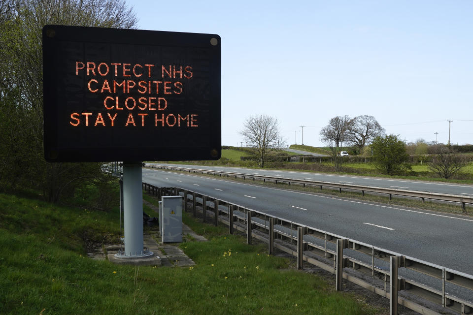 FLINT, WALES - APRIL 08: A sign next to the A55 main road into North Wales implores tourists to stay home and that campsites are closed during the pandemic lockdown on April 08, 2020 in Flint, Wales. There have been around 60,000 reported cases of the COVID-19 coronavirus in the United Kingdom and 7,000 deaths. The country is in its third week of lockdown measures aimed at slowing the spread of the virus. (Photo by Christopher Furlong/Getty Images)