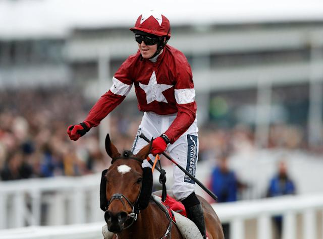 Horse Racing - Cheltenham Festival - Cheltenham Racecourse, Cheltenham, Britain - March 14, 2018 K M Donoghue celebrates winning the 16:10 Glenfarclas Chase on Tiger Roll Action Images via Reuters/Andrew Boyers
