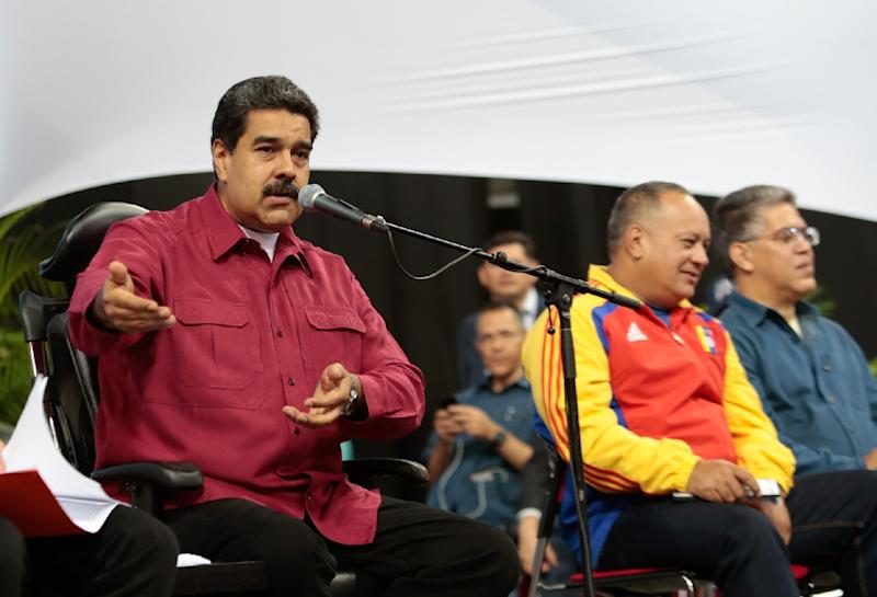 Venezuelan President Nicolas Maduro (L), shown in Caracas this week in this picture handed out by his office, rescheduled the inauguration of his controversial Constituent Assembly for Friday