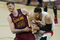 Cleveland Cavaliers Isaiah Hartenstein, left, and Toronto Raptors' Aron Baynes battle for the ball in the second half of an NBA basketball game, Saturday, April 10, 2021, in Cleveland. (AP Photo/Tony Dejak)