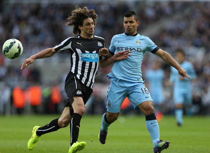 Newcastle United's defender Fabricio Coloccini vies with Manchester City's striker Sergio Aguero (R) during their English Premier League football match on August 17, 2014. Manchester City won the game 2-0