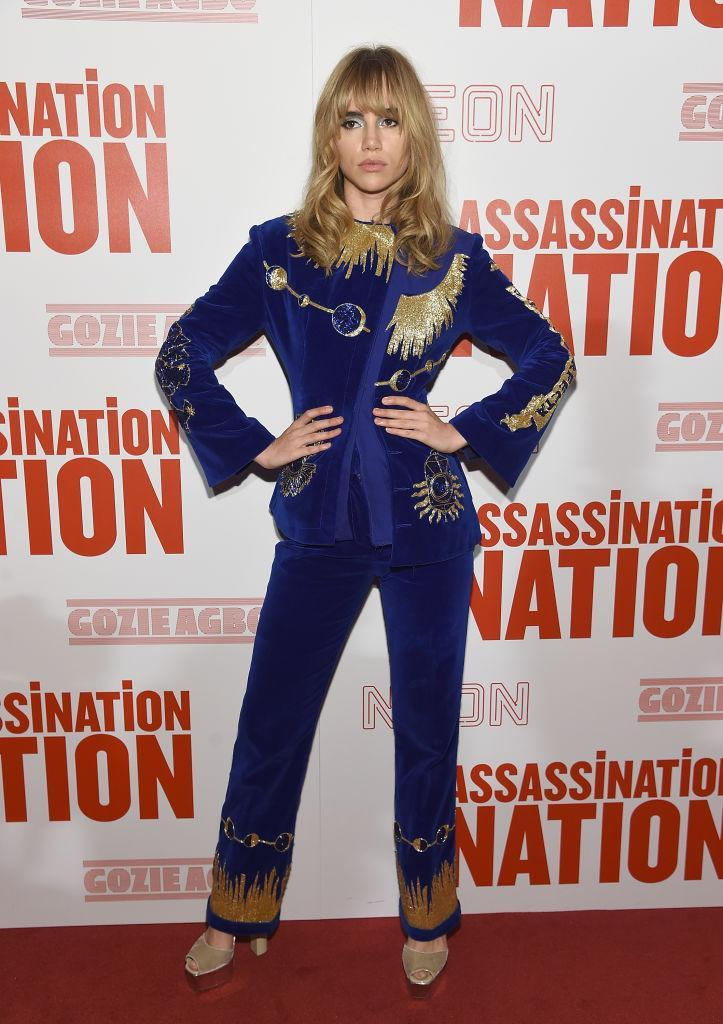 <p>For the New York premiere of 'Assassination Nation', Suki Waterhouse wore the velvet suit of dreams complete with glitzy platforms and a new '70s-inspired fringe. LOVE. <em>[Photo: Getty]</em> </p>