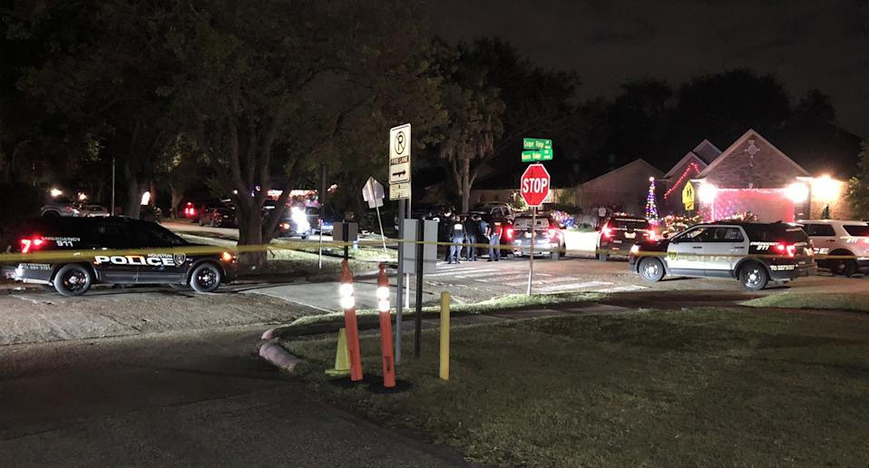 Houston police block off a Houston street after 30 people were discovered being held captive in a home