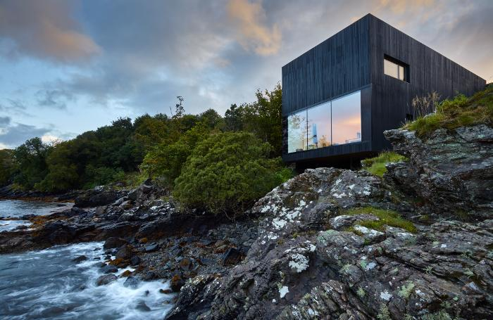 This black-timbered house on the Isle of Skye was built right next to the water's edge with the aim of showing its connection to the sea (Picture: Andrew Lee)