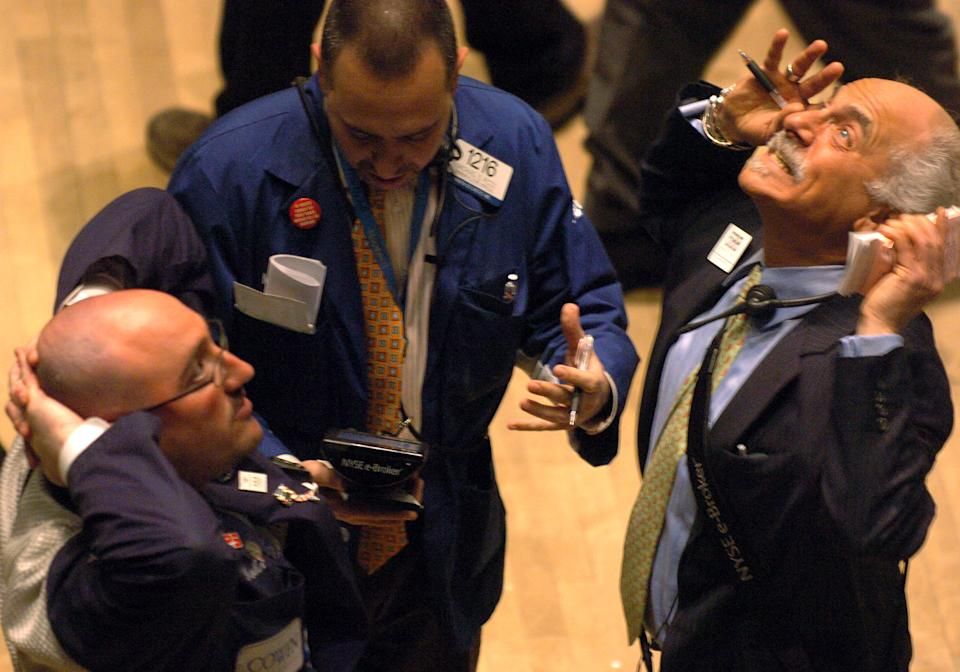 Traders look exasperated on the floor of the New York Stock Exchange. Photo: Andrew Savulich/NY Daily News Archive via Getty Images