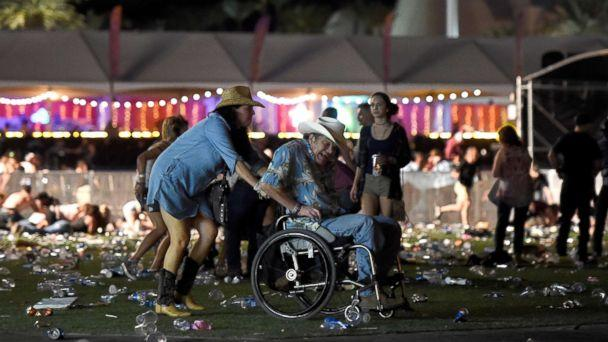 PHOTO: A man in a wheelchair is taken away from the Route 91 Harvest country music festival after gun fire was heard, Oct. 1, 2017 in Las Vegas. ( David Becker/Getty Images)
