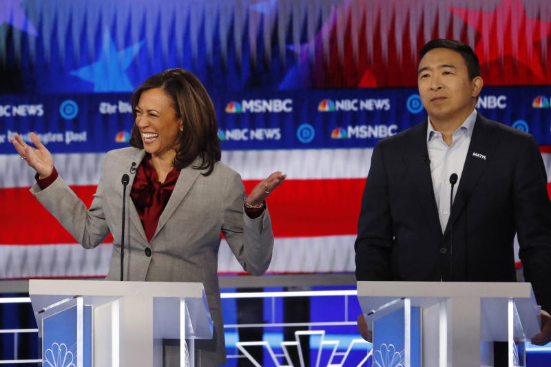 Democratic presidential candidate Sen. Kamala Harris, D-Calif., reacts while speaking as Democratic presidential candidate former technology executive Andrew Yang looks on during a Democratic presidential primary debate, Wednesday, Nov. 20, 2019, in Atlanta. (AP Photo/John Bazemore)