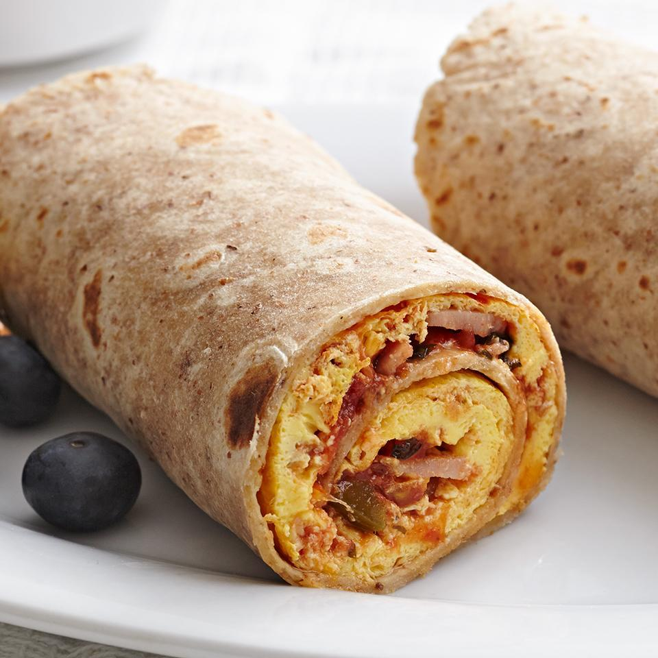 <p>This breakfast burrito is quick to make and easy to eat. Ham, egg and a dash of hot sauce cook up into an omelet and get rolled up in a delicious high-fiber tortilla for some fun fork-free eating.</p>