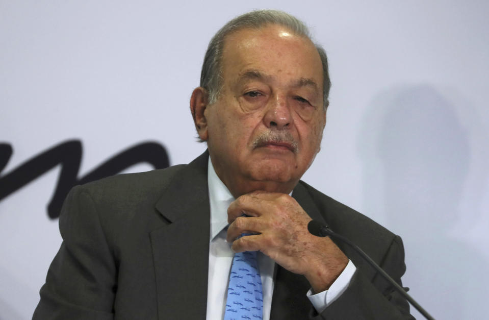 FILE - In this Oct. 16, 2019 file photo, Mexican billionaire Carlos Slim listens to a question during a news conference at his office in Mexico City. Slim's son said on Monday, Jan. 25, 2021, that his father has become infected with COVID-19 but that his symptoms are minor. (AP Photo/Fernando Llano, File)