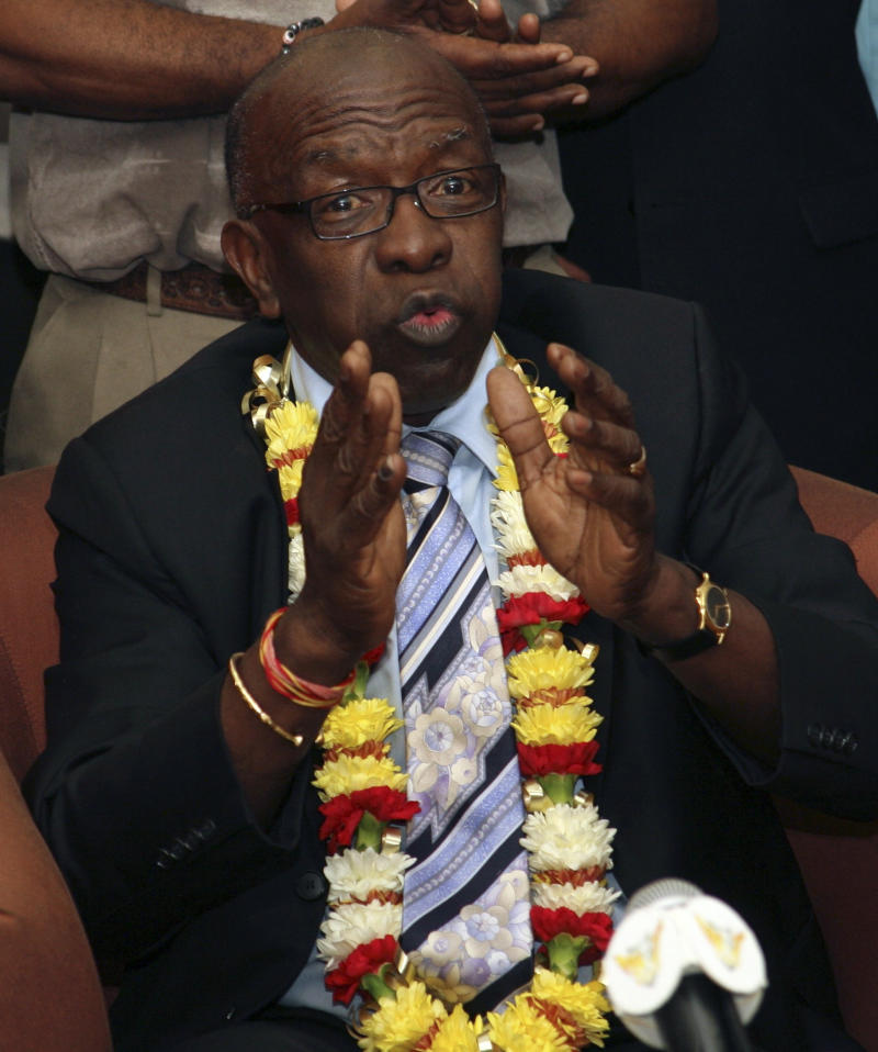 "FILE - This June 2, 2011 file photo shows former FIFA vice president Jack Warner gesturing during a news conference in Port-of-Spain, Trinidad. Warner has threatened to release a ""tsunami"" of corruption allegations against FIFA President Sepp Blatter. Warner said Tuesday, Oct. 18, 2011,  he will make the allegations after former presidential candidate Mohamed bin Hammam completes his appeal to the Court of Arbitration of Sport against a life ban for bribery. (AP Photo/Shirley Bahadur, File)"