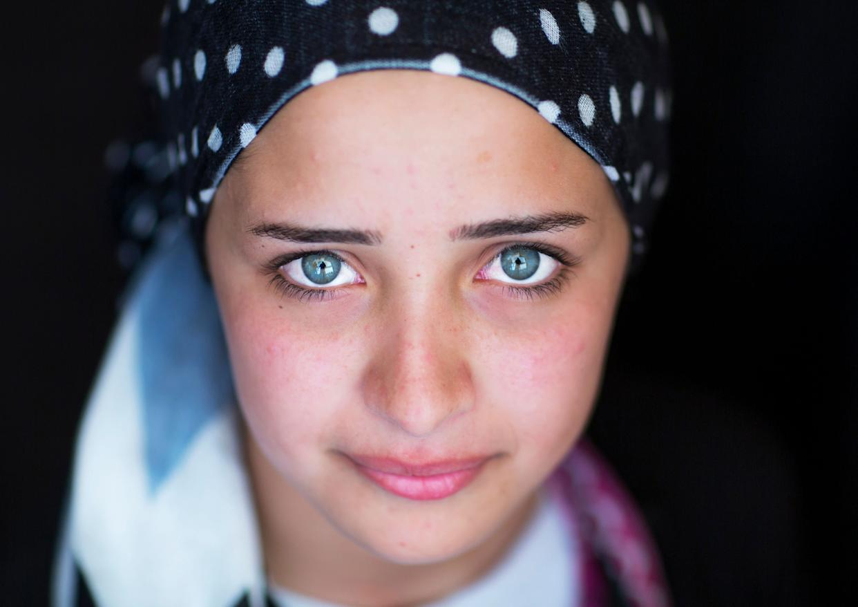 Close-up of a young syrian refugee face with blue eyes inErbil, Kurdistan, Iraq on Sep. 21, 2013.