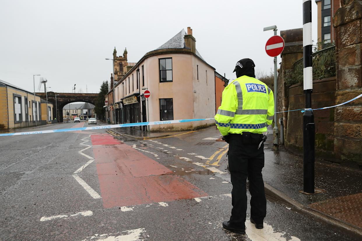 The scene on Portland Street in Kilmarnock, Ayrshire, where a 24-year-old woman was stabbed and later died in hospital. A 39-year old woman was also killed and a man died in a car crash in three incidents police believe are linked in the Kilmarnock area. Picture date: Friday February 5, 2021.
