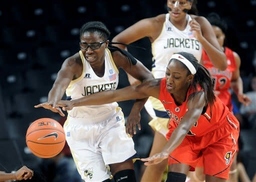 Georgia Tech guard Brittany Jackson, left, and Georgia guard Erika Ford (31) vie for the loose ball during the first half of an NCAA college basketball game in Atlanta, Sunday, Dec. 2, 2012. (AP Photo/John Amis)