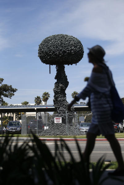 """In this Tuesday, July 10, 2012 photo, """"Chain Reaction,"""" a sculpture by Pulitzer Prize-winning cartoonist Paul Conrad, is seen in Santa Monica, Calif. After years of erosion by the ocean's salt air, """"Chain Reaction"""" is not in danger of exploding but of falling down. With repairs estimated to cost $300,000, city officials say the work by the late Conrad is a work of art that Santa Monica can no longer afford. (AP Photo/Jae C. Hong)"""