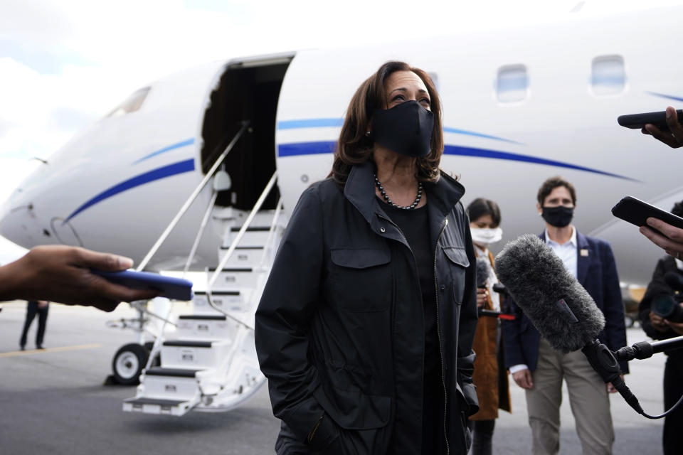 Democratic nominee for Vice President Sen. Kamala Harris speaks to reporters after landing for a campaign rally Sunday, Nov. 1, 2020, in Chamblee, Ga. (AP Photo/John Bazemore)