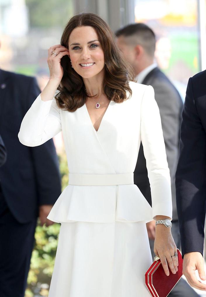 <p>Echoing the colors of the Polish flag, the Duchess of Cambridge wore a white Alexander McQueen suit with a ruby necklace, earrings, and ring. </p>