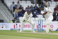 India's Cheteshwar Pujara, right, plays a shot during the third day of third test cricket match between England and India, at Headingley cricket ground in Leeds, England, Friday, Aug. 27, 2021. (AP Photo/Jon Super)