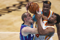Charlotte Hornets center Cody Zeller, left, and Atlanta Hawks forward Solomon Hill, right, the battle for the ball during the third quarter of an NBA basketball game in Charlotte, N.C., Sunday, April 11, 2021. (AP Photo/Nell Redmond)
