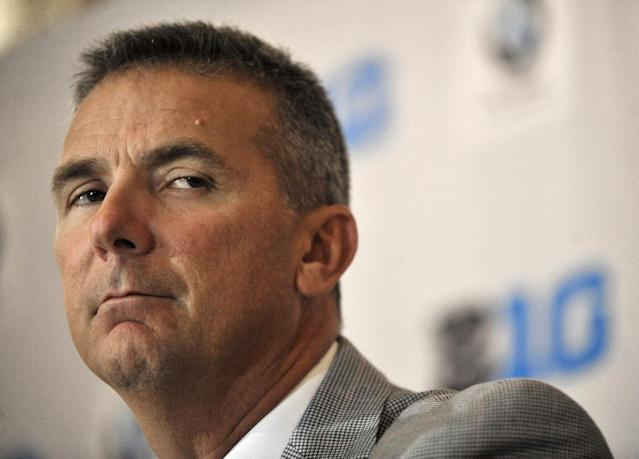 Ohio State head coach Urban Meyer talks to the media during the Big Ten Football Media Day in Chicago, Monday, July 28, 2014. (AP Photo/Paul Beaty)