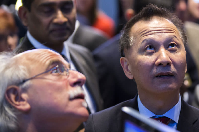 CEO of A10 Networks Lee Chen looks up at a digital board during the company's IPO on the floor of the New York Stock Exchange