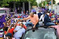 Ruling Dominican Liberation Party (PLD) candidate Gonzalo Castillo shakes hands with supporters in San Pedro de Macoris ahead vote