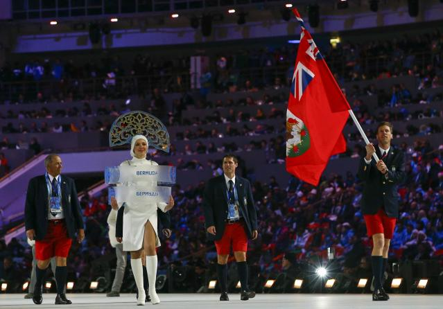 Bermuda's flag-bearer Tucker Murphy leads his country's contingent during the opening ceremony of the 2014 Sochi Winter Olympic Games at Fisht stadium February 7, 2014. REUTERS/Brian Snyder (RUSSIA - Tags: OLYMPICS SPORT)