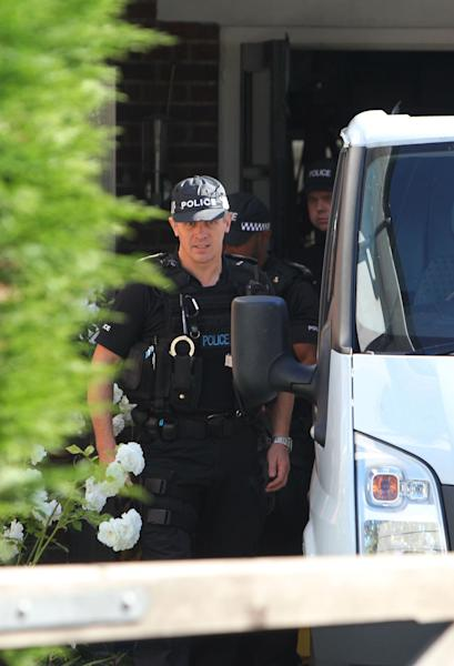 The home of Saad al-Hilli, in Claygate, England, who was shot dead on Wednesday with three others while vacationing in the French Alps, continues to be guarded by Surrey Police, who are assisting French police, Sunday, Sept. 9, 2012. The children of the al-Hilli family survived the killing, as 4-year-old daughter Zeena stayed hidden below the body of her dead mother, and 7-year-old Zaina who was shot in the shoulder and beaten. (AP Photo/Steve Parsons,PA) UNITED KINGDOM OUT - NO SALES - NO ARCHIVES