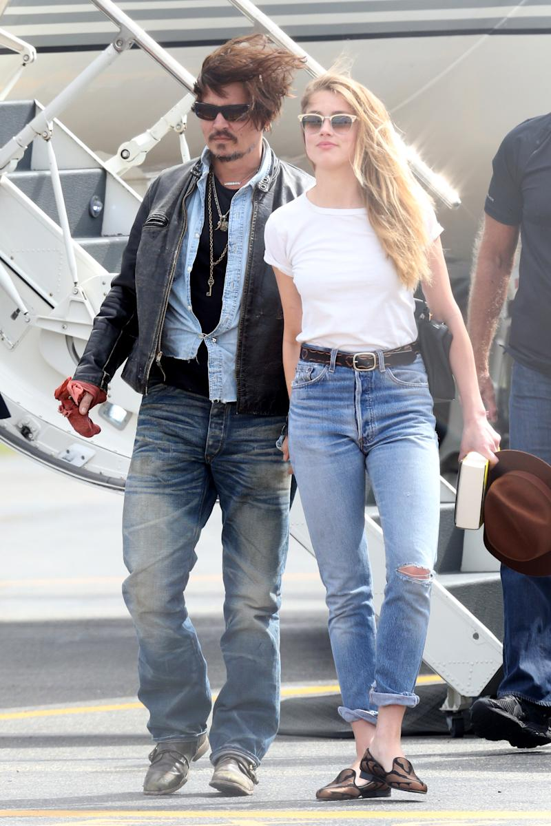 American actor Johnny Depp and wife Amber Heard arrive on a private jet at Brisbane Airport on April 21, 2015 in Brisbane, Australia.