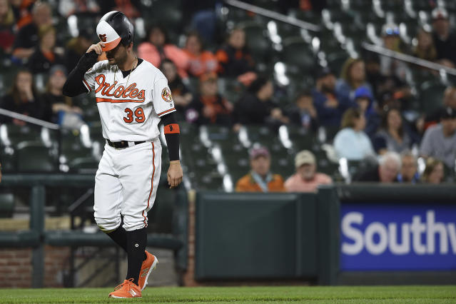 Baltimore Orioles' Renato Nunez walks to the dugout after being picked off by the catcher with the bases loaded in the fourth inning of a baseball game against the Chicago White Sox, Monday, April 22, 2019, in Baltimore. (AP Photo/Gail Burton)