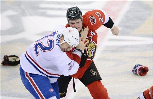 Ottawa Senators' Chris Neil fights with Montreal Canadiens' Travis Moen during the first period of Game 3 of their first-round NHL hockey Stanley Cup playoff series, Sunday, May 5, 2013, in Ottawa, Ontario. (AP Photo/The Canadian Press, Sean Kilpatrick)