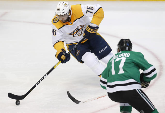 Nashville Predators defenseman P.K. Subban (76) controls the puck in front of Dallas Stars center Andrew Cogliano (17) during the first period of an NHL hockey game in Dallas, Tuesday, Feb. 19, 2019. (AP Photo/LM Otero)