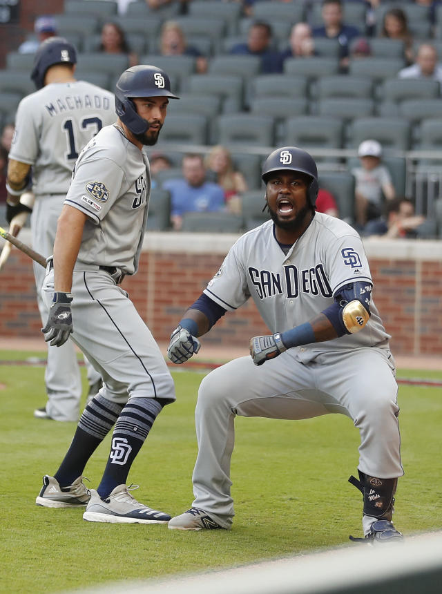 San Diego Padres' Franmil Reyes, right, reacts as teammate Eric Hosmer looks on after hitting a solo home run in the first inning of a baseball game against the Atlanta Braves Tuesday, April 30, 2019, in Atlanta. (AP Photo/John Bazemore)