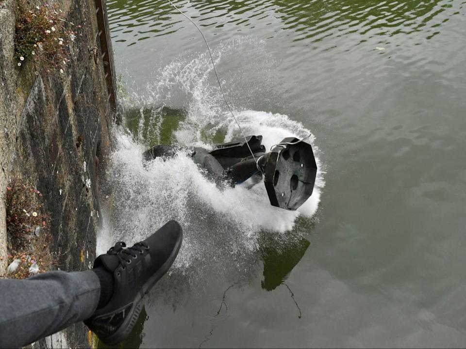 Colston statue being thrown in the river in JunePA