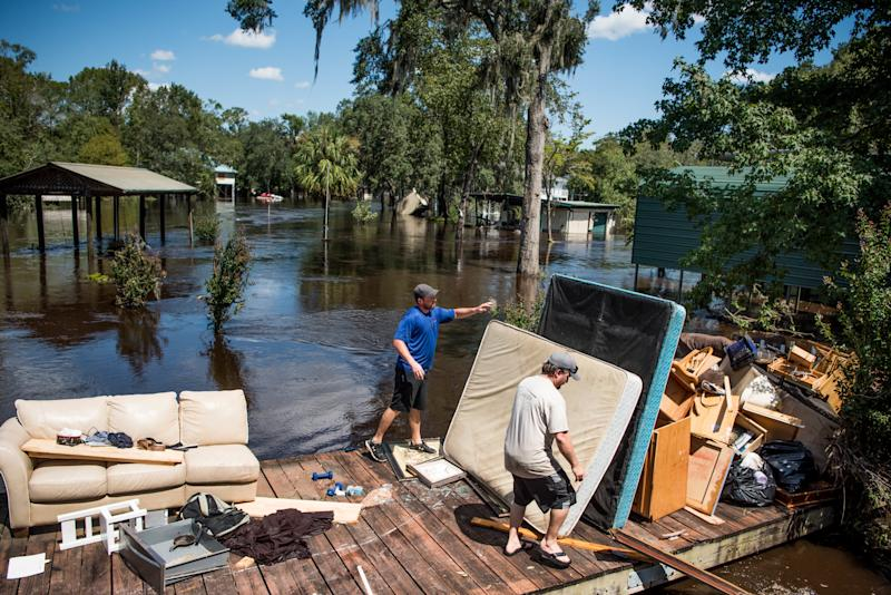 Marc St. Peter, left, and Chris Wisor lend a hand cleaning up as floodwaters from Hurricane Irma recede Wednesday in Middleburg, Florida. (Sean Rayford via Getty Images)