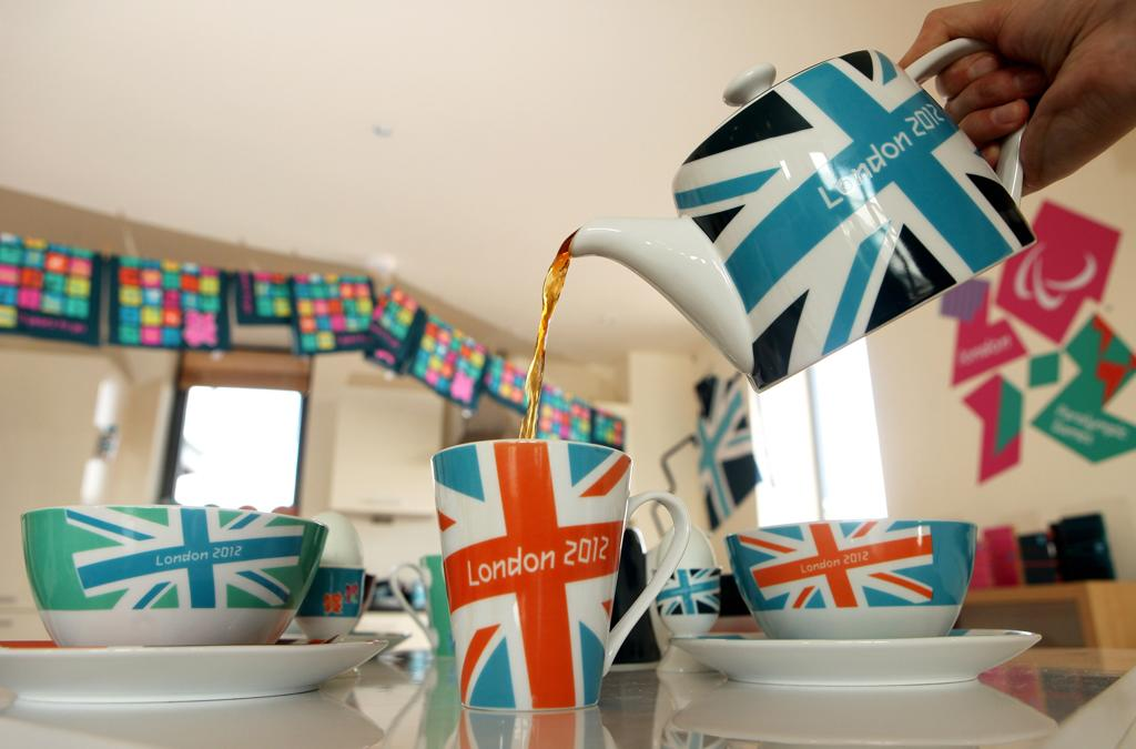A woman pours tea from a London 2012 branded tea set at the launch of the London Olympic Games official merchandise on July 30, 2010 in London, England. The merchandise is being launched with two years to go before the Games begin and features a range of goods including: clothing, towels, bedding, ceramics, stamps, coins, badges, mascot toys and soft furnishings.  (Photo by Oli Scarff/Getty Images)