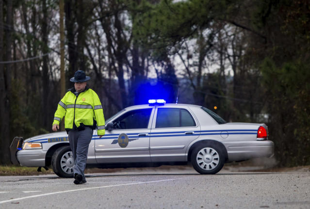 <p>A State Trooper directs people away from the site of an early morning train crash, Feb. 4, 2018, in Cayce, SC. (Photo: Jeff Blake/AP) </p>