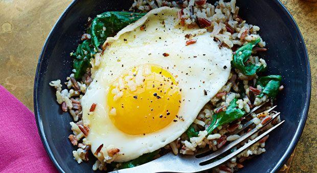 """<p>Here's an easy, healthy meal you can make in just a few minutes. It makes a great breakfast, or a light but filling dinner.</p><p><strong><a href=""""https://www.countryliving.com/food-drinks/recipes/a34749/wild-rice-spinach-egg-bowl-recipe-ghk0115/"""" rel=""""nofollow noopener"""" target=""""_blank"""" data-ylk=""""slk:Get the recipe"""" class=""""link rapid-noclick-resp"""">Get the recipe</a>.</strong></p><p><strong><a class=""""link rapid-noclick-resp"""" href=""""https://www.amazon.com/Minute-Ready-Serve-Multi-Grain-Medley/dp/B00DYDAOKG/?tag=syn-yahoo-20&ascsubtag=%5Bartid%7C10050.g.32969162%5Bsrc%7Cyahoo-us"""" rel=""""nofollow noopener"""" target=""""_blank"""" data-ylk=""""slk:SHOP MINUTE RICE"""">SHOP MINUTE RICE</a><br></strong></p>"""