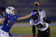 Kansas wide receiver Luke Grimm (80) reaches for the ball while covered by TCU linebacker Dee Winters (13) during the first half of an NCAA college football game in Lawrence, Kan., Saturday, Nov. 28, 2020. The pass was incomplete. (AP Photo/Orlin Wagner)