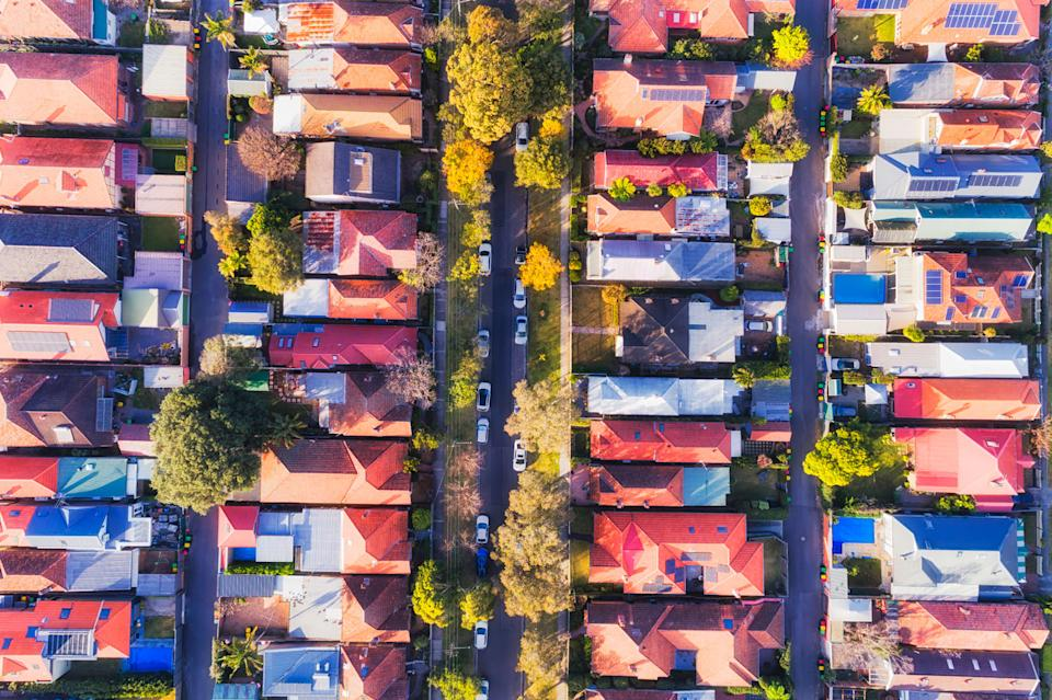 Pictured is a Sydney street on the North Shore, with houses lining the road. Several NSW suburbs placed on the top 10 lottery hotspot list.