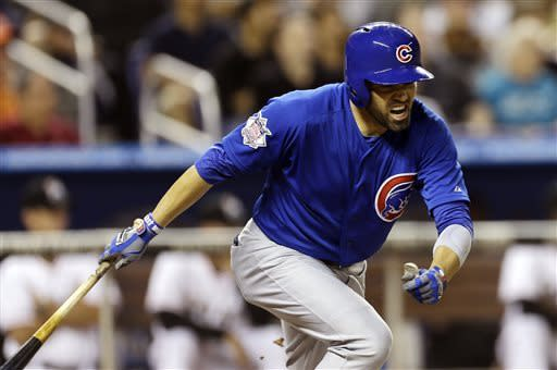 Chicago Cubs batter David DeJesus reacts after singling and driving one run in during the seventh inning of a baseball game against the Miami Marlins in Miami, Saturday, April 27, 2013. (AP Photo/J Pat Carter)
