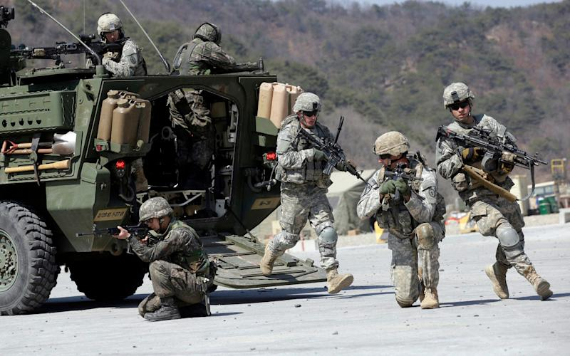 US Army soldiers and South Korean soldiers take their position during a demonstration at the Rodriquez Multi-Purpose Range Complex in Pocheon, north of Seoul, South Korea. - AP