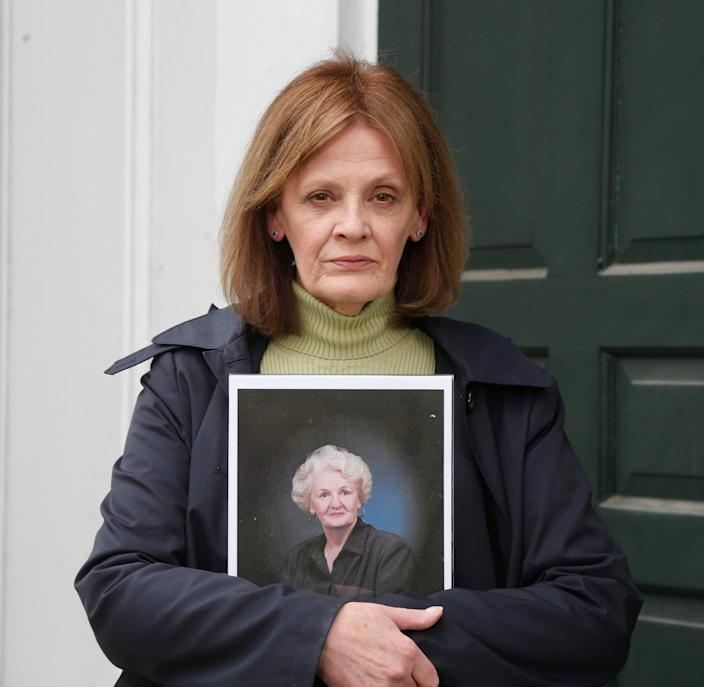 Kathleen Cole holds a portrait of his mother Dolores McGoldrick at the Hurley Reformed Church on April 29, 2020. McGoldrick died on COVID-19 in a hospital in North Holland on April 17.