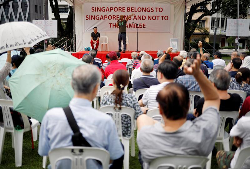 Organiser Gilbert Goh speaks to attendees during protest to call for investigations against Prime Minister Lee Hsien Loong in Singapore