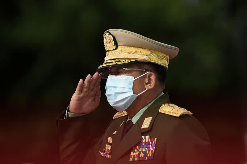 FILE PHOTO: Myanmar's Army Chief Min Aung Hlaing salutes during the Martyrs' Day ceremony in Yangon on July 19, 2020.