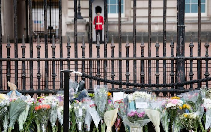 Members of the public lay flowers ourside Buckingham Palace in memory of The Duke of Edinburgh - David Rose for The Telegraph