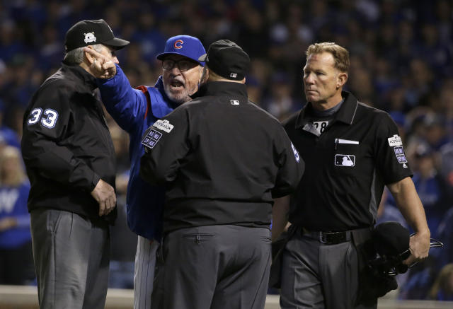 Chicago Cubs manager Joe Maddon argues with umpires. (AP Photo)
