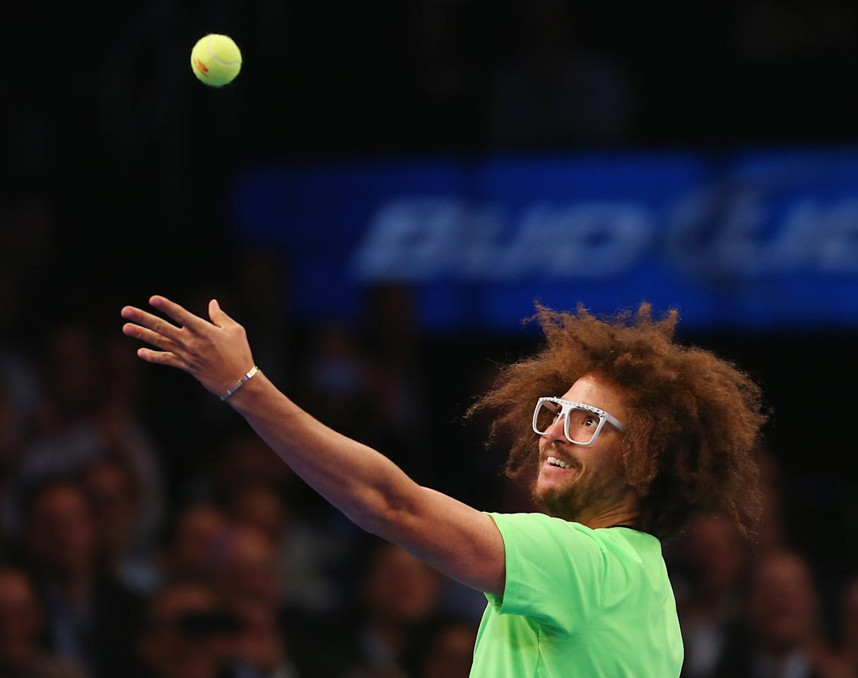 NEW YORK, NY - MARCH 04:  LMFAO singer Redfoo attempts to serve to Serena Williams of the USA in her match against Victoria Azarenka of Belarus during the BNP Paribas Showdown on March 4, 2013 at Madison Square Garden in New York City.  (Photo by Elsa/Getty Images)